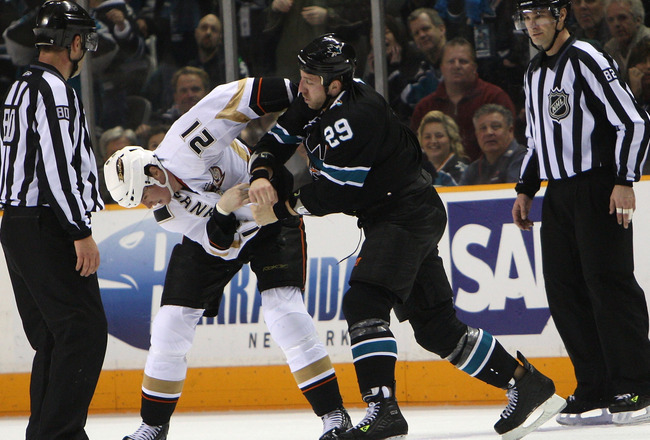 SAN JOSE, CA - DECEMBER 17:  Ryane Clowe #29 of the San Jose Sharks fights with Sheldon Brookbank #21 of the Anaheim Ducks during an NHL game at the HP Pavilion on December 17, 2009 in San Jose, California. (Photo by Jed Jacobsohn/Getty Images)