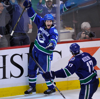 VANCOUVER, CANADA - MAY 18:  Kevin Bieksa #3 of the Vancouver Canucks celebrates his second period goal againstt the San Jose Sharks in Game Two of the Western Conference Finals during the 2011 Stanley Cup Playoffs at Rogers Arena on May 18, 2011 in Vanco