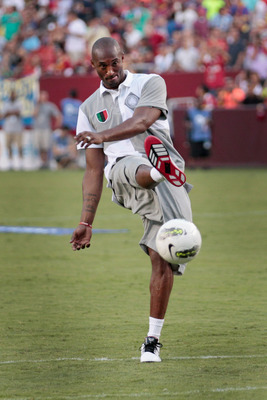 LANDOVER, MD - JULY 30: NBA basketball player Kobe Bryant kicks a soccer ball during half time of the Manchester United and Barcelona friendly match at FedExField on July 30, 2011 in Landover, Maryland.  (Photo by Rob Carr/Getty Images)