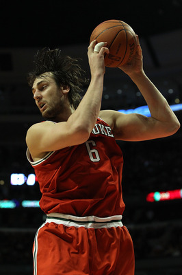CHICAGO, IL - DECEMBER 28: Andrew Bogut #6 of the Milwaukee Bucks pulls down a rebound against the Chicago Bulls at the United Center on December 28, 2010 in Chicago, Illinois. The Bulls defeated the Bucks 90-77. NOTE TO USER: User expressly acknowledges