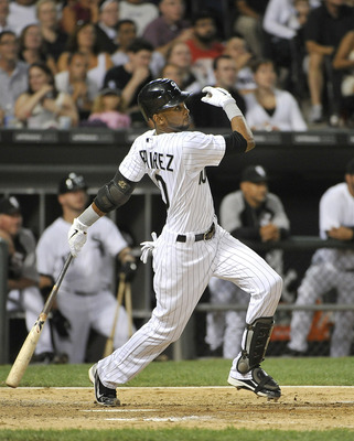 CHICAGO, IL - AUGUST 16:  Alexei Ramirez #10 of the Chicago White Sox follows through on an RBI triple scoring Paul Konerko during the fifth inning against the Cleveland Indians  at U.S. Cellular Field on August 16, 2011 in Chicago, Illinois.  (Photo by B