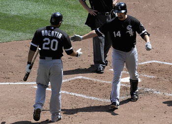 MINNEAPOLIS, MN - AUGUST 7: Carlos Quentin #20 of the Chicago White Sox congratulates Paul Konerko #14 of the Chicago White Sox on a solo home run against the Minnesota Twins in the fourth inning on August 7, 2011 at Target Field in Minneapolis, Minnesota