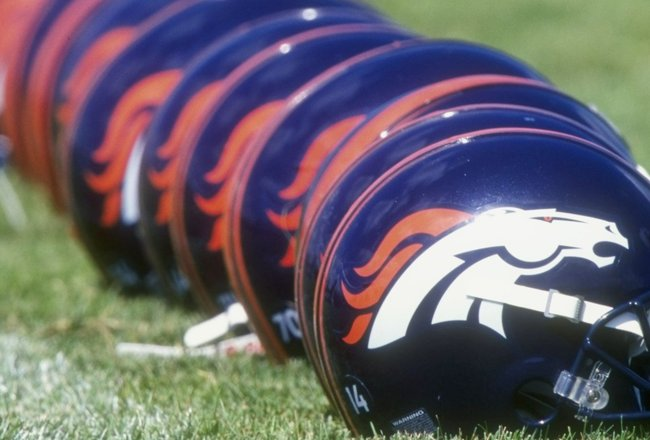 26 Jul 1998:  General view of Denver Bronco helmets lined up during the 1998 Denver Broncos training camp at the University of Northern Colorado in Greeley, Colorado. Mandatory Credit: Brian Bahr  /Allsport