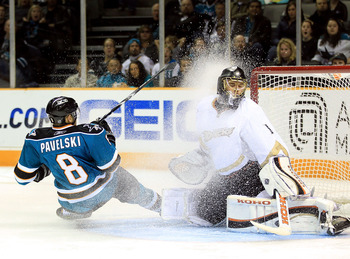SAN JOSE, CA - NOVEMBER 09:  Jonas Hiller #1 of the Anaheim Ducks is covered in ice when Joe Pavelski #8 of the San Jose Sharks skids to a stop in front of the goal at HP Pavilion on November 9, 2010 in San Jose, California.  (Photo by Ezra Shaw/Getty Ima