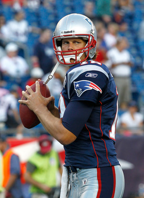FOXBORO, MA - AUGUST 11:  Tom Brady #12 of the New England Patriots completes a drill before a game against the Jacksonville Jaguars at Gillette Stadium on August 11, 2011 in Foxboro, Massachusetts. (Photo by Jim Rogash/Getty Images)