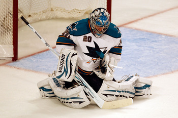 CHICAGO - MAY 23:  Goaltender Evgeni Nabokov #20 of the San Jose Sharks makes a second period save while taking on the Chicago Blackhawks in Game Four of the Western Conference Finals during the 2010 NHL Stanley Cup Playoffs at the United Center on May 23