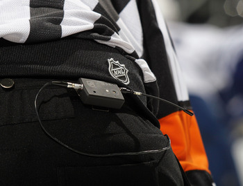 NEWARK, NJ - APRIL 06: Referee Don Van Massenhoven #21 wears the wireless transmitter so that his calls can be heard by spectators at the game between the New Jersey Devils and the Toronto Maple Leafs at the Prudential Center on April 6, 2011 in Newark, N