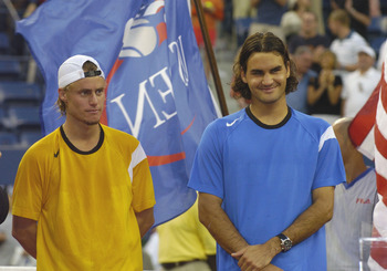 Roger Federer  and Lleyton Hewitt  await the coin toss before   the men's singles final September 12, 2004  at the 2004 US Open in New York. (Photo by A. Messerschmidt/Getty Images)
