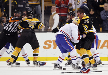 BOSTON, MA - FEBRUARY 09:  Johnny Boychuk #55 of the Boston Bruins fights with Jaroslav Spacek #6 of the Montreal Canadiens is Shawn Thornton #22 of the Bruins and Brian Gionta #21 of the Canadiens fight on February 9, 2011 at the TD Garden in Boston, Mas