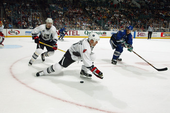 SUNRISE, FL - FEBRUARY 2:  Scott Stevens #4 of the Eastern Conference All-Stars attempts to make a hand pass against the Western Conference All-Stars during the 53rd NHL All-Star Game at the Office Depot Center on February 2, 2003 in Sunrise, Florida.  Th