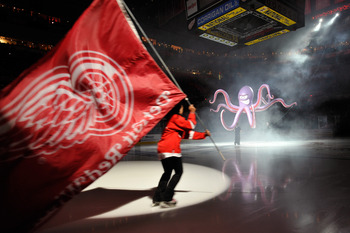 DETROIT - MAY 4:  Pregame ceremonies before Game Three of the Western Conference Semifinals between the San Jose Sharks and the Detroit Red Wings included an octopus dropping from the scoreboard and skaters with flags during the 2011 NHL Stanley Cup Playo