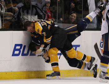 BOSTON - NOVEMBER 07:  Paul Gaustad #28 of the Buffalo Sabres  and Shawn Thornton #22 of the Boston Bruins fight in the third period on November 7, 2009 at the TD Garden in Boston, Massachusetts. The Bruins defeated the Sabres 4-2.  (Photo by Elsa/Getty I