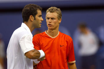 9 Sep 2001: Lleyton Hewitt of Australia shakes hands with Pete Sampras of the USA  following the men's final match of the US Open at the USTA National Tennis Center in Flushing, New York. Hewitt defeats Sampras 7-6 (4), 6-1, 6-1. DIGITAL IMAGE. Mandatory