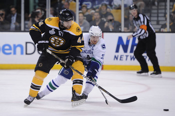 BOSTON, MA - JUNE 06:  Dennis Seidenberg #44 of the Boston Bruins against Henrik Sedin #33 of the Vancouver Canucks during Game Three of the 2011 NHL Stanley Cup Final at TD Garden on June 6, 2011 in Boston, Massachusetts.  (Photo by Harry How/Getty Image