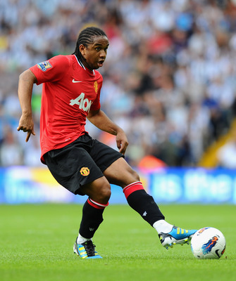 WEST BROMWICH, ENGLAND - AUGUST 14: Anderson of Manchester United in action during the Barclays Premier League match between West Bromwich Albion and Manchester United at The Hawthorns on August 14, 2011 in West Bromwich, England.  (Photo by Mike Hewitt/G