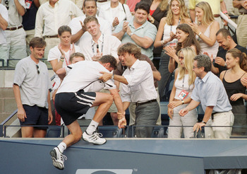 10 Sep 2000:  Marat Safin of Russia climbs into his entourages box after defeating Pete Sampras to win the men's singles final of the US Open Tennis Championships at the USTA National Tennis Center in Flushing Meadows Corona Park, Flushing, New York. Mand