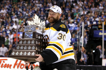 VANCOUVER, BC - JUNE 15:  Tim Thomas #30 of the Boston Bruins is awarded the Conn Smythe Trophy after defeating the Vancouver Canucks in Game Seven of the 2011 NHL Stanley Cup Final at Rogers Arena on June 15, 2011 in Vancouver, British Columbia, Canada.