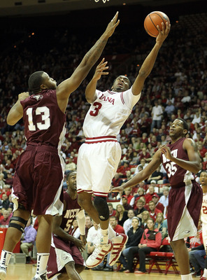 BLOOMINGTON, IN - NOVEMBER 23:  Maurice Creek #3 of the Indiana Hoosiers shoots the ball while defended by David Best #13 of the North Carolina Central Eagles at Assembly Hall on November 23, 2010 in Bloomington, Indiana.  Indiana won 72-56.  (Photo by An