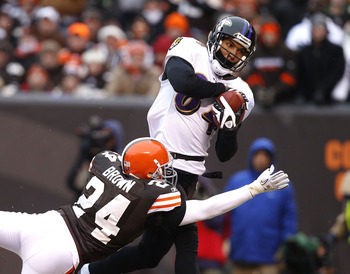 CLEVELAND - DECEMBER 26:  Wide receiver T.J. Houshmandzadeh, #84 of the Baltimore Ravens catches a touchdown pass over defensive back Sheldon Brown, #24 of the Cleveland Browns at Cleveland Browns Stadium on December 26, 2010 in Cleveland, Ohio.  (Photo b