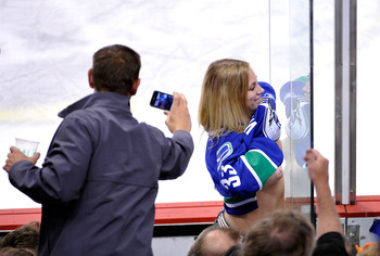 VANCOUVER, CANADA - MAY 18:  (EDITORS NOTE: Image contains nudity)  A Vancouver Canucks fan exposes herself to a San Jose Sharks player in the penalty box during Game Two of the Western Conference Finals between the San Jose Sharks and the Vancouver Canuc