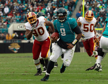 JACKSONVILLE, FL - DECEMBER 26: Quarterback David Garrard #9 of the Jacksonville Jaguars runs for a touchdaown during the game against the Washington Redskins at EverBank Field on December 26, 2010 in Jacksonville, Florida.  (Photo by Sam Greenwood/Getty