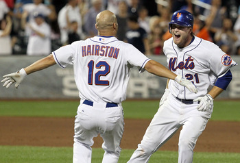NEW YORK, NY - AUGUST 08:  Lucas Duda #21 of the New York Mets celebrates his walk off two-run ninth inning single against the San Diego Padres with teammate Scott Hairston #12 at Citi Field on August 8, 2011 in the Flushing neighborhood of the Queens bor