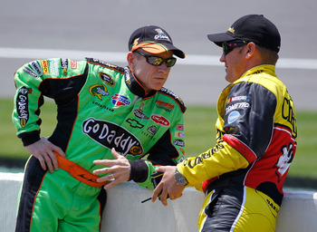 BROOKLYN, MI - JUNE 18:  Mark Martin, driver of the #5 GoDaddy.com Chevrolet, speaks with Clint Bowyer, driver of the #33 Cheerios/Hamburger Helper Chevrolet, during qualifying for the NASCAR Sprint Cup Series Heluva Good! Sour Cream Dips 400 at Michigan
