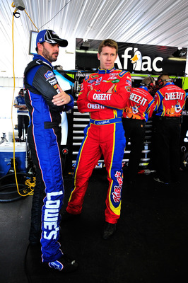 LONG POND, PA - JUNE 10:  Carl Edwards, driver of the #99 Kellogg's Ford, talks to Jimmie Johnson, driver of the #48 Lowe's Chevrolet, in the garage area during practice for the NASCAR Sprint Cup Series 5-Hour Energy 500 at Pocono Raceway on June 10, 2011