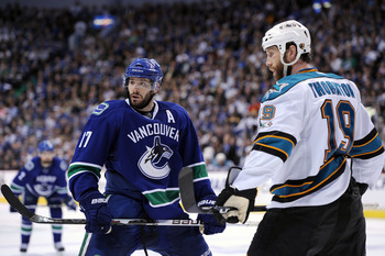 VANCOUVER, CANADA - MAY 18:  Joe Thornton #19 of the San Jose Sharks and Ryan Kesler #17 of the Vancouver Canucks wait to take a faceoff in Game Two of the Western Conference Finals during the 2011 Stanley Cup Playoffs at Rogers Arena on May 18, 2011 in V