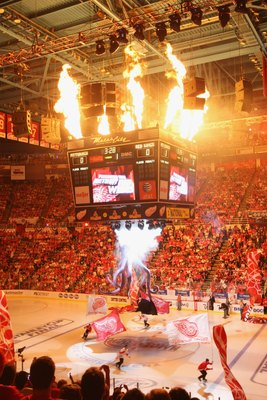DETROIT - JUNE 6:  Fireworks go off as skaters carry flags around the ice prior to the start of Game Five of the 2009 NHL Stanley Cup Finals between the Pittsburgh Penguins and the Detroit Red Wings at Joe Louis Arena on June 6, 2009 in Detroit, Michigan.