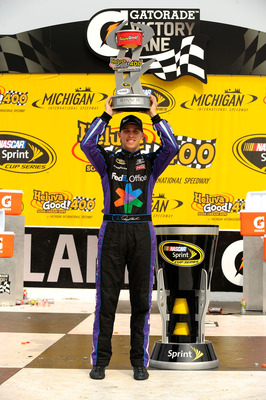 BROOKLYN, MI - JUNE 19:  Denny Hamlin, driver of the #11 FedEx Office Toyota, celebrates in victory lane after winning the NASCAR Sprint Cup Series Heluva Good! Sour Cream Dips 400 at Michigan International Speedway on June 19, 2011 in Brooklyn, Michigan.