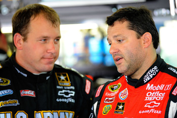 CHARLOTTE, NC - MAY 28:  Ryan Newman (L), driver of the #39 U.S. Army Chevrolet, talks with Tony Stewart (R), driver of the #14 Office Depot/Mobil 1 Chevrolet, in the garage during practice for the NASCAR Sprint Cup Series Coca-Cola 600 at Charlotte Motor