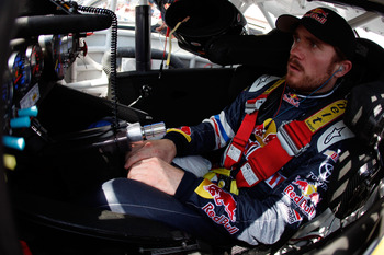BROOKLYN, MI - JUNE 17:  Brian Vickers, driver of the #83 Red Bull Toyota, sits in his car during practice for the NASCAR Sprint Cup Series Heluva Good! Sour Cream Dips 400 at Michigan International Speedway on June 17, 2011 in Brooklyn, Michigan.  (Photo