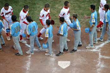 SOUTH WILLAMSPORT, PA - AUGUST 29:  Players from Japan and the United States Little League teams, shake hands after the game on August 29, 2010 in South Willamsport, Pennsylvania. Japan won the Little League World Series Championship 4-1.  (Photo by Drew