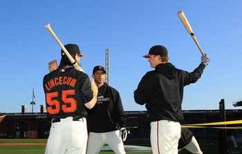 SAN FRANCISCO - OCTOBER 18:  Tim Lincecum #55 of the San Francisco Giants speaks to Matt Cain #18 and Madison Bumgarner #40 during a workout session for the NLCS at AT&T Park on October 18, 2010 in San Francisco, California.  (Photo by Ezra Shaw/Getty Ima