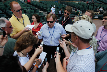 CHICAGO - JUNE 25: General manager Jim Hendry of the Chicago Cubs (center) talks to reporters before a game against the Chicago White Sox at U.S. Cellular Field on June 25, 2010 in Chicago, Illinois. (Photo by Jonathan Daniel/Getty Images)