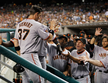 DETROIT, MI - JULY 01: Chris Stewart #37 of the San Francisco Giants celebrates with teammates after scoring on a ninth inning bases loaded walk while playing the Detroit Tigers at Comerica Park on July 1,  2011 in Detroit, Michigan. San Francisco won the