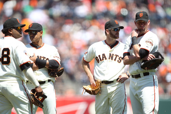 SAN FRANCISCO, CA - AUGUST 10:  Pablo Sandoval #48 of the San Francisco Giants looks on with Orlando Cabrera #43, Jeff Keppinger #8 and Aubrey Huff #17 against the Pittsburgh Pirates at AT&T Park on August 10, 2011 in San Francisco, California.  (Photo by