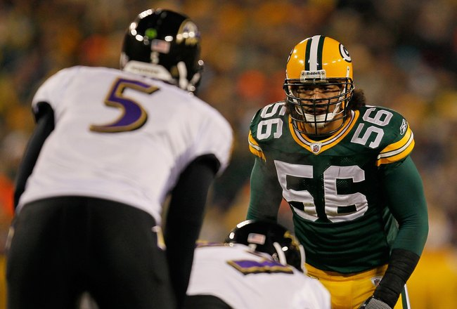 GREEN BAY, WI - DECEMBER 07: Nick Barnett #56 of the Green Bay Packers stares at Joe Flacco #5 of the Baltimore Ravens before the snap at Lambeau Field on December 7, 2009 in Green Bay, Wisconsin. The Packers defeated the Ravens 27-17. (Photo by Jonathan