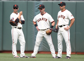 SAN FRANCISCO, CA - AUGUST 06:  Cody Ross #13, Aaron Rowand #33 and Carlos Beltran #15 of the San Francisco Giants look on against the Philadelphia Phillies at AT&T Park on August 6, 2011 in San Francisco, California.  (Photo by Jed Jacobsohn/Getty Images