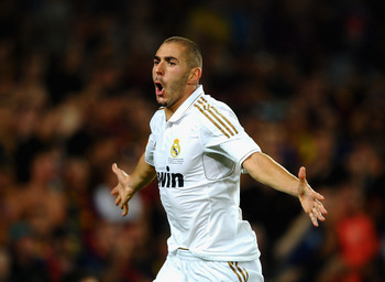 BARCELONA, SPAIN - AUGUST 17: Karim Benzema of Real Madrid celebrates scoring the second goal during the Super Cup second leg match between Barcelona and Real Madrid at Nou Camp on August 17, 2011 in Barcelona, Spain.  (Photo by Laurence Griffiths/Getty I
