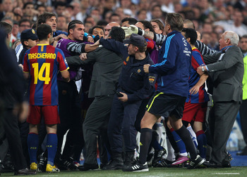 MADRID, SPAIN - APRIL 27:  Jose Pinto of Barcelona clashes with Real Madrid official as the players leave the pitch at half time during the UEFA Champions League Semi Final first leg match between Real Madrid and Barcelona at Estadio Santiago Bernabeu on