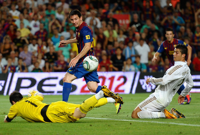 BARCELONA, SPAIN - AUGUST 17:  Lionel Messi of Barcelona scores past Iker Casillas of Real Madrid during the Super Cup second leg match between Barcelona and Real Madrid at Nou Camp on August 17, 2011 in Barcelona, Spain.  (Photo by Laurence Griffiths/Get