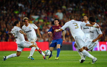 BARCELONA, SPAIN - AUGUST 17: Lionel Messi of Messi of Barcelona is the centre of attention during the Super Cup second leg match between Barcelona and Real Madrid at Nou Camp on August 17, 2011 in Barcelona, Spain.  (Photo by Laurence Griffiths/Getty Ima