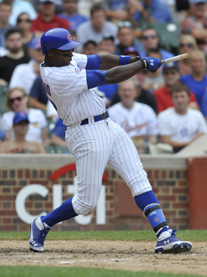 CHICAGO, IL - JULY 24: Alfonso Soriano #12 of the Chicago Cubs breaks his bat and hits an RBI single in the eighth inning against the  Houston Astros on July 24, 2011 at Wrigley Field in Chicago, Illinois. The Cubs defeated the Astros 5-4 in ten innings.