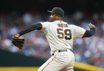 PHOENIX, AZ - APRIL 16:  Relief pitcher Guillermo Mota #59 of the San Francisco Giants pitches against the Arizona Diamondbacks during the Major League Baseball game at Chase Field on April 16, 2011 in Phoenix, Arizona. The Giants defeated the Diamondback