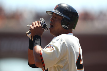 SAN FRANCISCO, CA - AUGUST 03:  Orlando Cabrera #43 of the San Francisco Giants reacts after being tagged out at third by Cody Ransom of the Arizona Diamondbacks in the second inning at AT&T Park on August 3, 2011 in San Francisco, California.  (Photo by