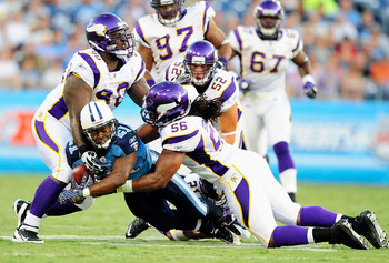 NASHVILLE, TN - AUGUST 13:  Fred Evans #90 and E.J. Henderson #50 of the Minnesota Vikings tackle Javon Ringer #21 of the Tennessee Titans during a preseason game at LP Field on August 13, 2011 in Nashville, Tennessee.  (Photo by Grant Halverson/Getty Ima