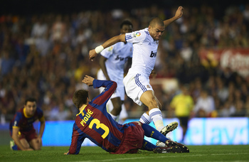 VALENCIA, BARCELONA - APRIL 20: Gerard Pique of Barcelona and Pepe (R) of Real Madrid competes for the ball during the Copa del Rey final match between Real Madrid and Barcelona at Estadio Mestalla on April 20, 2011 in Valencia, Spain. Real Madrid won 1-0