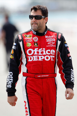WATKINS GLEN, NY - AUGUST 13:  Tony Stewart, driver of the #14 Office Depot/Mobil 1 Chevrolet, walks on the grid during qualifying for the NASCAR Sprint Cup Series Heluva Good! Sour Cream Dips at the Glen at Watkins Glen International on August 13, 2011 i